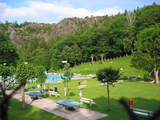 A scenic view of the swimming pool and its landscape