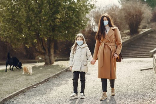 Woman and her daugher wearing face masks